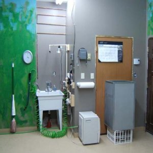 cham room shower stall, wash basin, dehumidifier, mop, and door to feeder room.